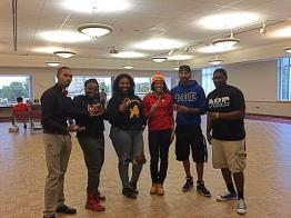 Members of NPHC volunteer at the Youth Empowerment Summit and perform a step for the high school students. Photo credit: Christina Gardner