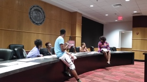 Executive board members listen to junior Ryan Justice and freshman Olivia Obi discuss t-shirt designs and ask for input from general members.